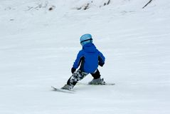A boy downhill skiing. A little boy downhill skiing training Stock Photography