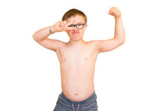 Boy With Downs Syndrome Flexing His Muscles Royalty Free Stock Image