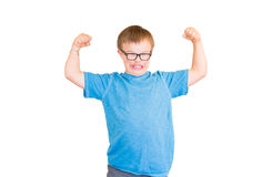 Boy With Downs Syndrome Flexing His Muscles Royalty Free Stock Images