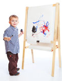 A boy draw on a blackboard royalty free stock photography
