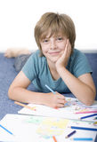 Boy draw with crayons Stock Image