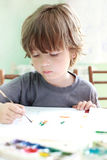 Boy draw in home. Happy boy draw in home Royalty Free Stock Photography