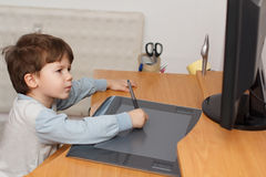 Boy draw on tablet Stock Photos