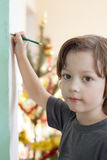 Boy draw on wall Stock Image