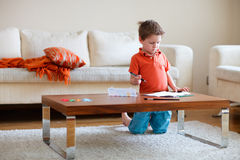 Boy drawing. Lifestyle photo of boy drawing at home royalty free stock photography