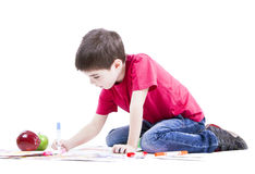 Boy drawing. Image of a yuong boy drawing on white Stock Photo