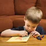 Boy drawing. royalty free stock photography