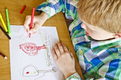 Boy drawing Stock Photo