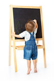 A boy is drawing on a blackboard Royalty Free Stock Photo