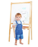 A boy is drawing on a blackboard Royalty Free Stock Image