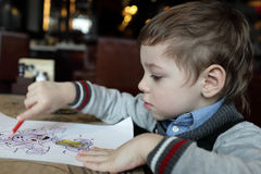 Boy drawing at the cafe Stock Photos