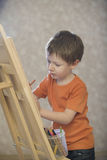 Boy Drawing On Canvas Stock Photos