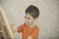Boy Drawing On Canvas Stock Image