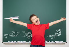 Boy drawing fish on school board Stock Image