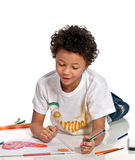Boy drawing on the floor Royalty Free Stock Photography