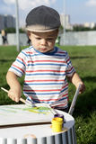 Boy drawing gouache Stock Photo