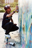 Boy drawing graffiti Royalty Free Stock Photos