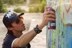 Boy drawing graffiti Stock Photo