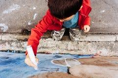 Boy drawing graffiti Stock Image
