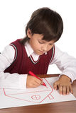 Boy drawing house Royalty Free Stock Images