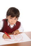 Boy drawing house Royalty Free Stock Photos