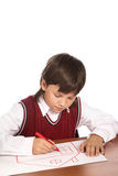 Boy drawing house Royalty Free Stock Image