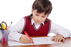 Boy drawing house Stock Images