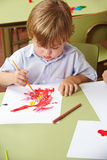 Boy drawing in kindergarten Royalty Free Stock Image