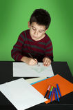 Boy drawing with markers Royalty Free Stock Photo