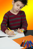 Boy drawing with markers Royalty Free Stock Photography