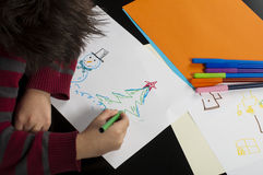 Boy drawing with markers Stock Photos