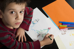 Boy drawing with markers Royalty Free Stock Images