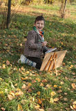 Boy drawing outdoor Royalty Free Stock Image