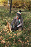 Boy drawing outdoor in autumn Royalty Free Stock Image