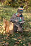 Boy drawing outdoor in autumn Stock Image