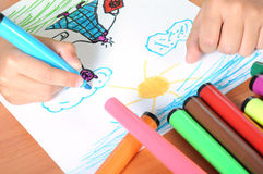 Boy drawing on paper Royalty Free Stock Images