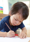 Boy drawing Stock Photos