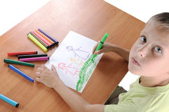 Boy drawing on paper with crayons Stock Photography