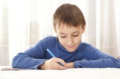 Boy drawing on paper Royalty Free Stock Photo