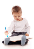 Boy drawing with a pencil. Over white background Stock Photos