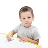 Boy drawing with pencil. Isolated on the white background Royalty Free Stock Photos
