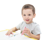 Boy drawing with pencil. Isolated on the white background Royalty Free Stock Images