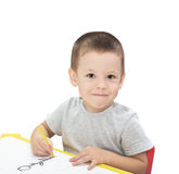 Boy drawing with pencil isolated. On the white background Stock Photos