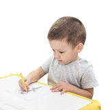 Boy drawing with pencil isolated. On the white background Stock Photo