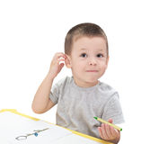 Boy drawing with pencil. Isolated on the white background Stock Images