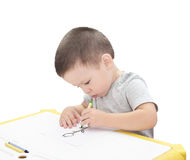 Boy drawing with pencil isolated. On the white background Stock Photography