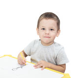 Boy drawing with pencil isolated Stock Photography