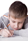 Boy drawing a pencil picture lying. On the floor isolated on white Stock Images