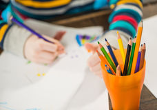 Boy drawing with pencils Royalty Free Stock Photo