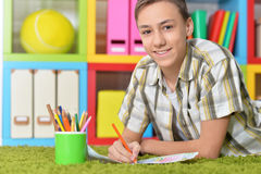 Boy drawing with pencils Stock Images